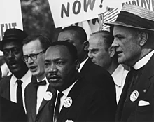 220px-civil_rights_march_on_washington,_d.c._(dr._martin_luther_king,_jr._and_mathew_ahmann_in_a_crowd.)_-_nara_-_542015_-_restoration